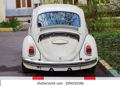 Moscow, Russia - May 1, 2018: White retro economy car - Volkswagen Beetle parked on the old street. Back view