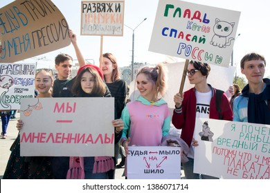 Moscow, RUSSIA - MAY 1, 2019: Russia Celebrates the Absurd and Illogical at Annual Monstration. Activists with a poster: Pat of cats, save Russia