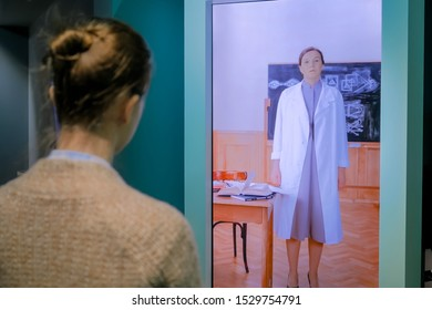 MOSCOW, RUSSIA - MAY 1, 2019: Modern Museum. Woman watching educational video presentation on display of interactive kiosk. Education, science and learning concept