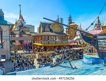 MOSCOW, RUSSIA - MAY 10, 2015: The replica of the wooden ship on sea, made of blue timbers with the mansions and izba houses of Izmailovsky market-town on the background, on May 10 in Moscow.