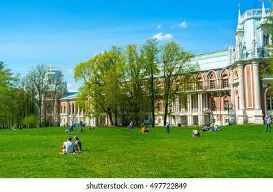 MOSCOW, RUSSIA - MAY 10, 2015: The picnic on the lawn with a view on Grand Palace of Tsaritsyno Imperial Residence, on May 10 in Moscow.