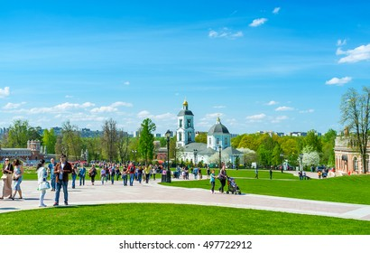 MOSCOW, RUSSIA - MAY 10, 2015: The people walk across the square to the Church of Our Lady Life-Giving Spring in Tsaritsino complex, on May 10 in Moscow.