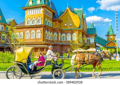 MOSCOW, RUSSIA - MAY 10, 2015: The ride on fiacre with the coachman, dressed in old-style traditional costume around the wooden Grand Palace in Kolomenskoye, on May 10 in Moscow.