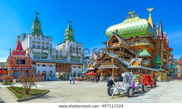 MOSCOW, RUSSIA - MAY 10, 2015: Panorama of the central square of Izmailovsky Kremlin with the timbered Tsar's Palace and huge decorative central gate with green towers, on May 10 in Moscow.