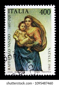 MOSCOW, RUSSIA - MAY 10, 2018: A stamp printed in Italy shows Painting by Raffaelo Sanzio, Christmas, serie, circa 1983