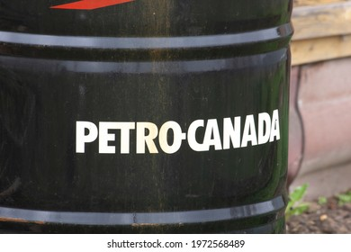 Moscow Russia - May 10, 2021: Black old oil barrel with the inscription Petro Canada