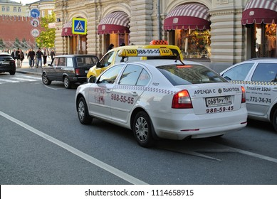 MOSCOW - RUSSIA, MAY 11, 2014: russian taxi Skoda Octavia cars nearby the Red Square and Moscow Kremlin