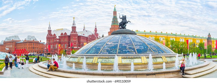 MOSCOW, RUSSIA - MAY 11, 2015: The panoramic view on main cupola of underground shopping mall Okhotny Ryad, designed in form of  fountain, called Hours of the World, on May 11 in Moscow