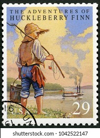 MOSCOW, RUSSIA - MAY 11, 2017: A stamp printed in USA shows The Adventures of Huckleberry Finn by Mark Twain, Classic Books, 1993