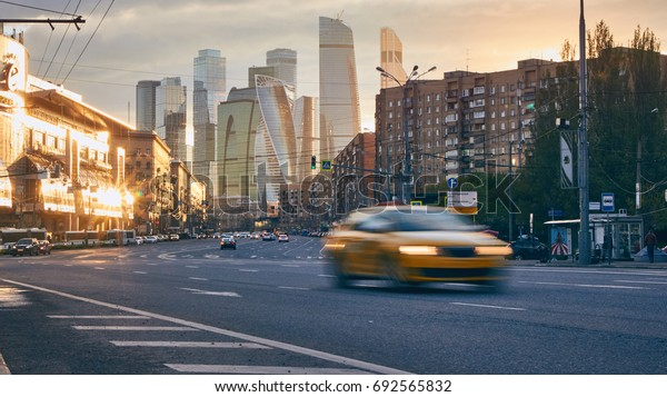 Moscow, Russia - May 12, 2017: City of city at sunset with the skyscrapers of the Moscow International Business Center (also known as Moscow City) at background and traffic with taxi at foreground.