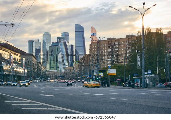 Moscow, Russia - May 12, 2017: City at sunset with the skyscrapers of the Moscow International Business Center (also known as Moscow City) at background and traffic at foreground.