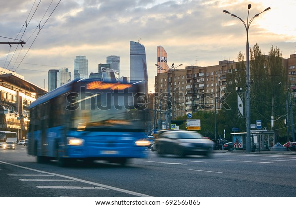 Moscow, Russia - May 12, 2017: City at sunset with the skyscrapers of the Moscow International Business Center (also known as Moscow City) at background and traffic with public bus at foreground.