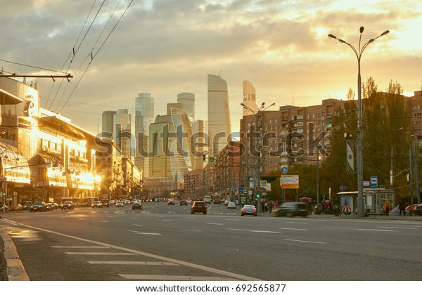 Moscow, Russia - May 12, 2017: Cityscape of city at sunset with the skyscrapers of the Moscow International Business Center (also known as Moscow City) at background and traffic at foreground.