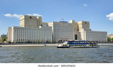 """MOSCOW, RUSSIA - May 12, 2018 Passenger cruise ship """"Christina"""" floating on River Moskva (Moscow) passing Russian National Defense Control Center on Frunzenskaya embankment during River Boat Parade"""