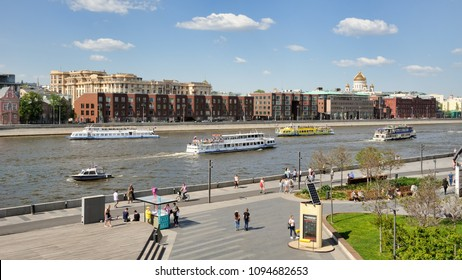 MOSCOW, RUSSIA - May 12, 2018 Passenger riverboats float up and down the river Moskva (Moskva) at Krymskaya (Crimean) Embankment during the 1st River Boat Parade 2018 on a nice sunny spring day.