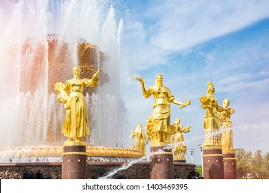MOSCOW, RUSSIA - MAY 12, 2019- Public fountain of friendship of people at VDNH city park exhibition in Moscow, Russia. Beautiful architecture of the golden fountain. Copy space