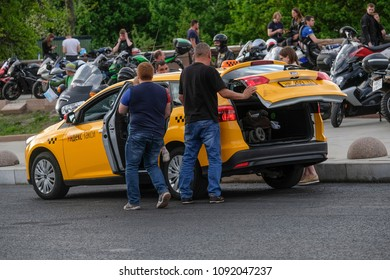 Moscow, Russia - May, 13, 2018: passengers load their luggage in a taxi in Moscow, Russia