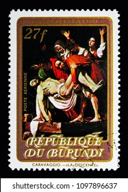 MOSCOW, RUSSIA - MAY 13, 2018: A stamp printed in Burundi shows Descent, Painting by Caravaggio, Easter serie, circa 1973