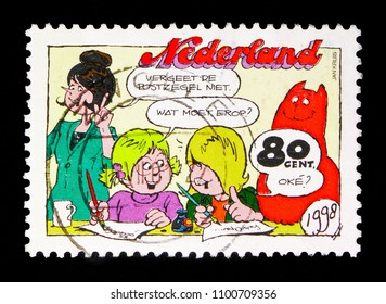 MOSCOW, RUSSIA - MAY 13, 2018: A stamp printed in Netherlands shows Jan Jans & the kids: Cathy and Jeremy write a letter, Comics serie, circa 1998