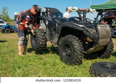 MOSCOW, RUSSIA - MAY 13, 2018: Replacing the wheel before the competition, class ATV, in the first stage of the racing series RZR CAMP 2018, Auto-Moto Track Burtsevo