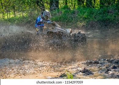 MOSCOW, RUSSIA - MAY 13, 2018: Unidentifiable athlete, class ATV, in the first stage of the racing series RZR CAMP 2018, motorcycle station Burtsevo