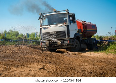 MOSCOW, RUSSIA - MAY 13, 2018: Watering machine watering the track and fighting dust, in the first stage of the racing series RZR CAMP 2018, motorcycle station Burtsevo