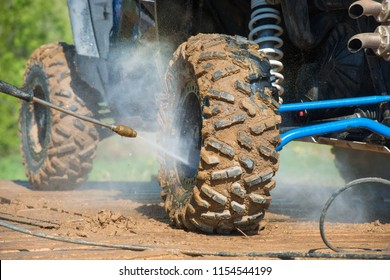 MOSCOW, RUSSIA - MAY 13, 2018: Wash sports equipment after the event, in the first stage of the racing series RZR CAMP 2018, Auto-Moto Track Burtsevo