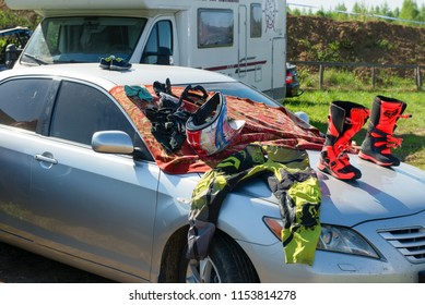 MOSCOW, RUSSIA - MAY 13, 2018:Sportswear is dried on the hood of the car, in the first stage of the racing series RZR CAMP 2018, Auto-Moto Track Burtsevo