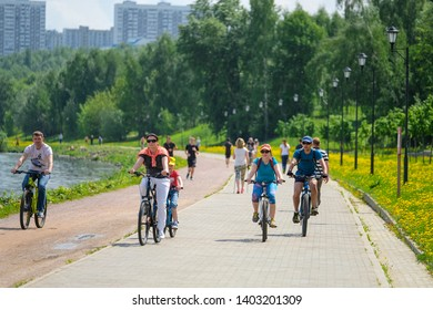 Moscow, Russia - May, 13, 2019: the image of runners and cyclists on the tracks of Kolomenskoye park in Moscow