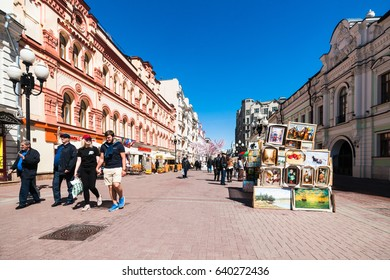 MOSCOW, RUSSIA - MAY 14, 2017: Arbat street of the city. Pedestrian street, one of the main tourist attractions of Moscow, full of shops and restaurants. Selling fine art on Arbat street.