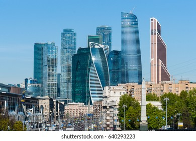MOSCOW, RUSSIA - MAY 15, 2017: Skyscrapers of the International Business Center Moscow City commands the view of Bolshaya (Large) Dorogomilovskaya street in sunny morning. Blue sky background.