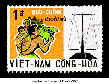 MOSCOW, RUSSIA - MAY 15, 2018: A stamp printed in Vietnam shows People and scale, serie, circa 1959