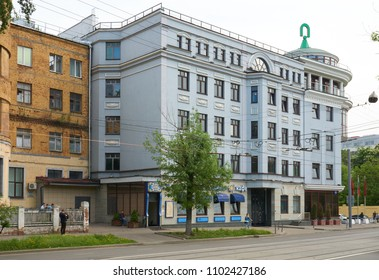 Moscow, Russia - May 16, 2018: Blue old house on Dubininskaya street, asian food restaurant on the ground floor
