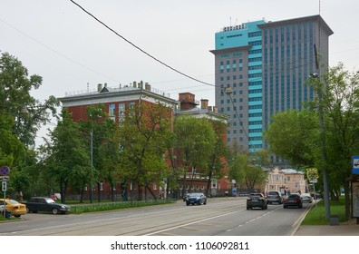 Moscow, Russia - May 16, 2018: View of Dubininskaya street, gray and blue modern building is headquarters of Rosneft russian oil company