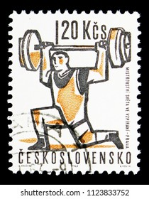 MOSCOW, RUSSIA - MAY 17, 2018: A stamp printed in Czechoslovakia shows Weight lifter, Sport serie, circa 1963