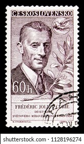 MOSCOW, RUSSIA - MAY 17, 2018: A stamp printed in Czechoslovakia shows Frederic Joliot Curie, Famous people serie, circa 1959