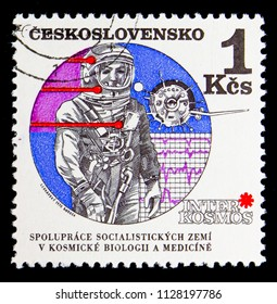 MOSCOW, RUSSIA - MAY 17, 2018: A stamp printed in Czechoslovakia shows Astronaut and Vostok satellite, Interkosmos serie, circa 1970