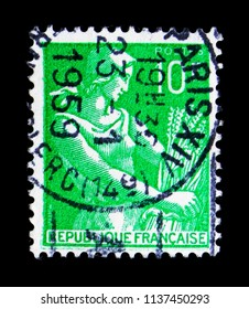 MOSCOW, RUSSIA - MAY 17, 2018: A stamp printed in France shows Reaper, Type Reaper serie, circa 1959