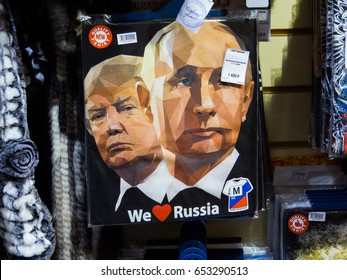 """MOSCOW, RUSSIA - MAY 19, 2017:  Souvenir T-shirts with Putin and Trump and the text """"We love Russia""""."""