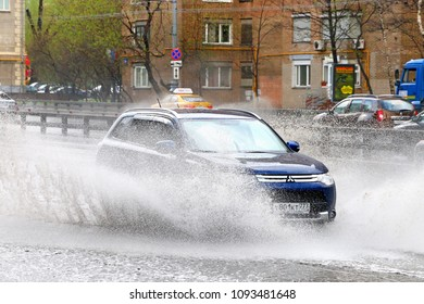 Moscow, Russia - May 2, 2018: Motor car Mitsubishi Outlander in the city street during a heavy rain.