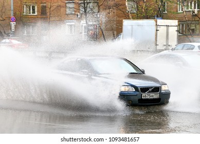 Moscow, Russia - May 2, 2018: Motor car Volvo S60 in the city street during a heavy rain.