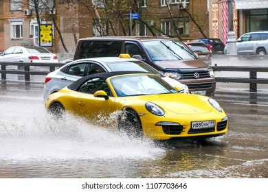 Moscow, Russia - May 2, 2018: Sports car Porsche 911 (991) in the city street during a heavy rain.