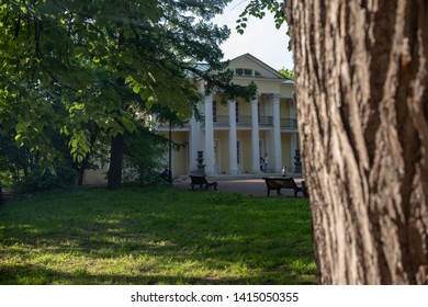 MOSCOW, RUSSIA - May 20, 2019: People walking on alleys of city garden. Summer house of count Orlov in Neskuchny garden in Moscow.