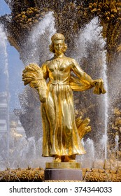 MOSCOW, RUSSIA - MAY, 2015: Fountain Friendship of the people and the Central pavilion on VVC (VDNH). The sculpture, which symbolizes Latvia