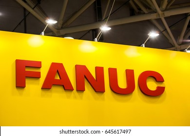 Moscow, Russia - May, 2017: Fanuc company logo on the wall. Fanuc provides automation products and services such as robotics and computer numerical control systems