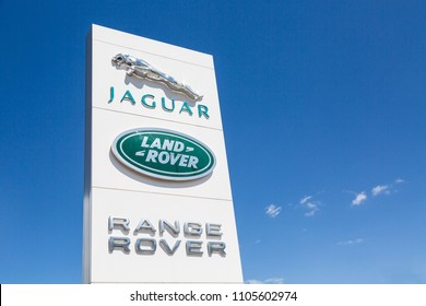 Moscow, Russia - May, 2018: Jaguar and Land Rover logo sign against blue sky. Jaguar and Land Rover are British multinational famous luxury car manufacturers.