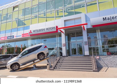 Moscow, Russia - May, 2018: Mitsubishi automobile reseller with new Mitsubishi Outlander model near the entrance. Mitsubishi is a japanese manufacturer of automobiles and commercial vehicles.