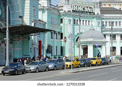 MOSCOW, RUSSIA - MAY, 2018: Taxis stand near the sidewalk near the entrance to the Belorussky railway station in Moscow