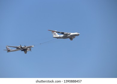 Moscow, Russia - May 2019: Air tanker Ilyushin IL-78 Midas and turboprop powered bomber Tu-95 Bear simulate in-flight refueling at Parade of Victory in World War II