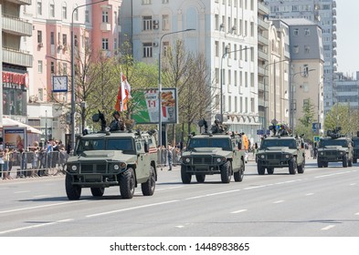 MOSCOW, RUSSIA - MAY 2019: Column of military equipment returning along New Arbat from rehearsal of Victory Parade on Red Square. Armored cars Tigr-M.